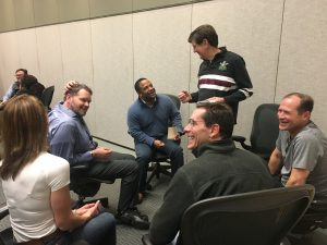 A group of physicians sit in circles during an improv activity