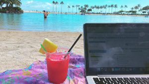 Computer and drink at the beach