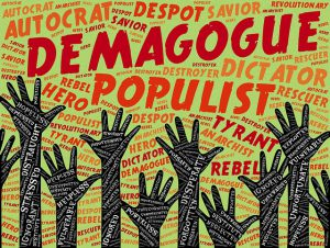 Graphic of hands raised with word cloud with words such as Demagogue, Populist, Dictator, Tyrant etc.