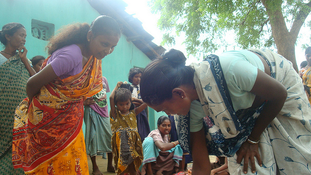 Facilitator Sumitra leads women's group in prioritizing community health concerns