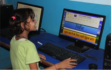 One of the girls at little stars playing the updated version of TypeTime.