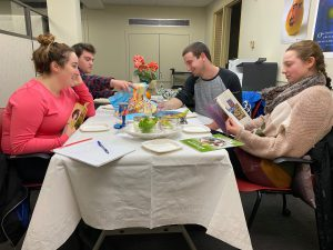 A group of undergraduate fellows reviewing Passover materials.