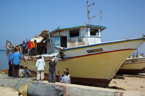 A Gazan fishing boat damaged by gunfire for leaving the designated fishing zone