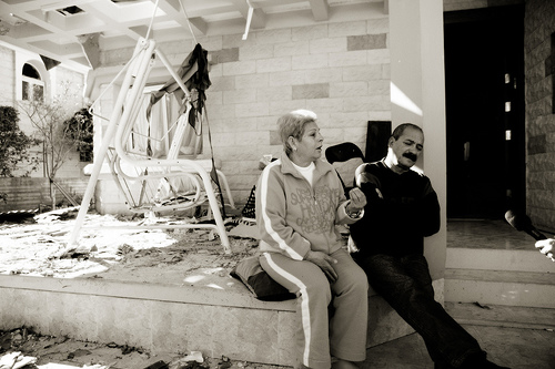 An israeli couple sitting outside the rubble of their former home. Their house, like many others in southern Israel, has been destroyed by Hamas rockets fired from Gaza.