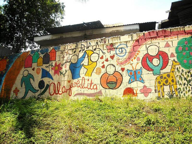 A mural painted by FIMRC volunteerson the wall of the FIMRC clinic in Alajuelita