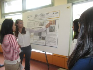 Presenting our research to a judge at the Poster Symposium