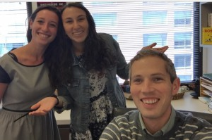 Rachel, my co-intern and I, pose with our supervisor, Joshua, for a quick picture at his desk.