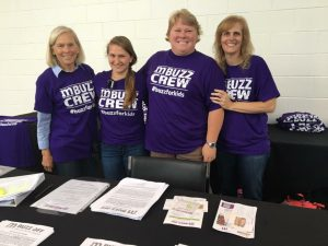 Working the Volunteer Registration table the day of the Buzz Off!