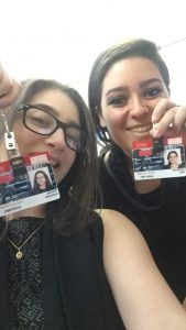 A photo of me and my inspiring fellow research intern, Carolina, with our Boston University research badges!
