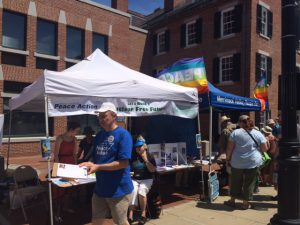 Cole Harrison (Executive Director of Massachusetts Peace Action) petitioning at the Lowell Folk Festival.