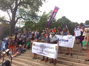 August 9, 2016 ~ Activists arrive on Boston Common for a MAPA event to commemorate 71st anniversary of the atomic attacks on Hiroshima and Nagasaki and the 2nd anniversary of the death of Michael Brown in Ferguson, MO.