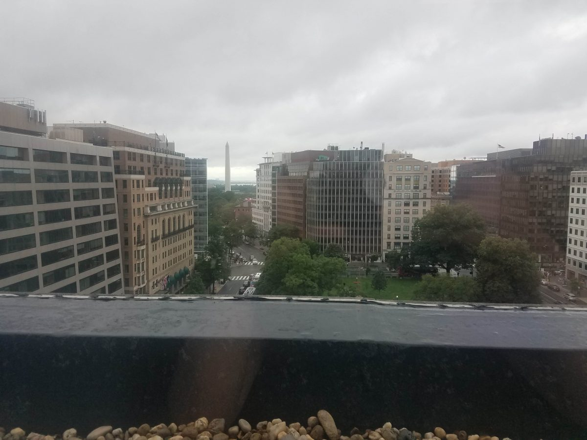 A cloudy city view featuring the Washington Monument.