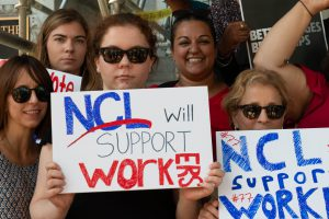 Members of the NCL team expressing the League's support for one fair wage through posters.