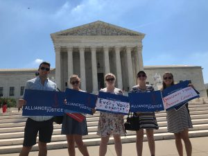 5 interns with signs from Alliance for Justice standing in front of the Supreme Court.