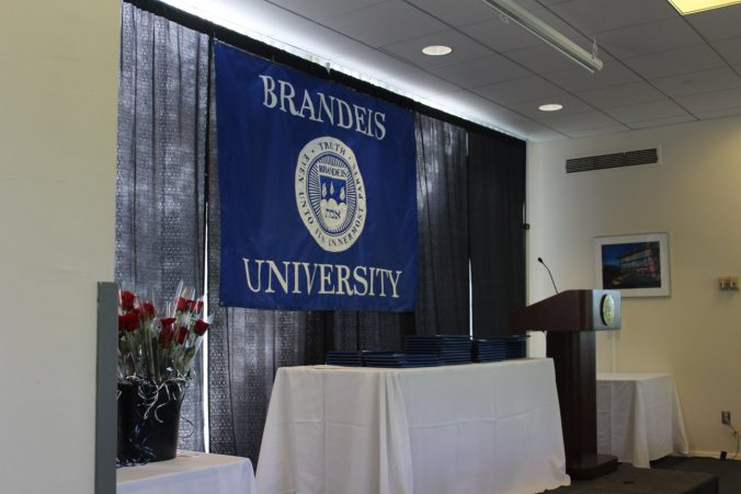 Commencement stage with Brandeis banner